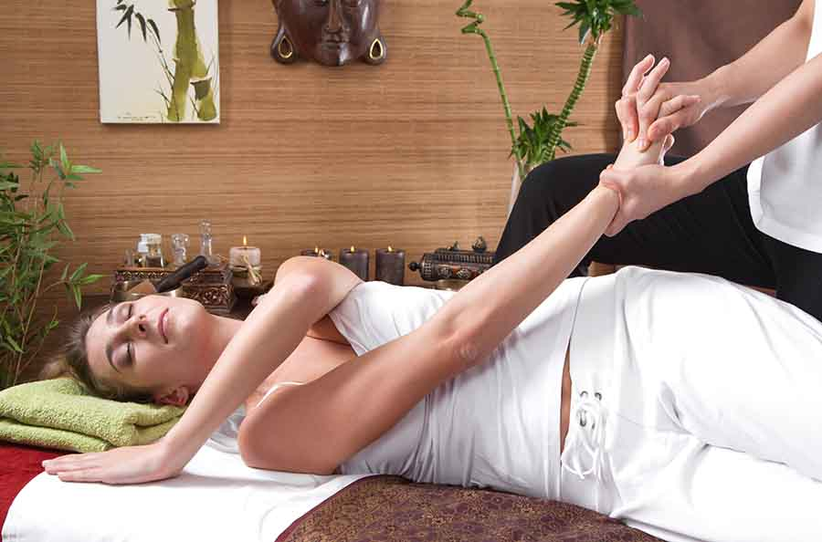 TCM singapore massage on lady's hand to improve overall health