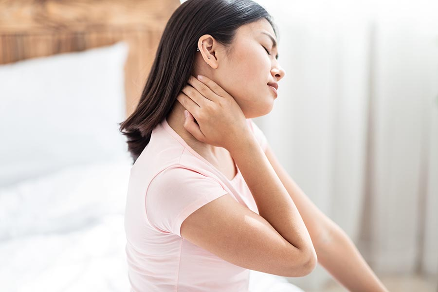 lady being bothered by neck pain