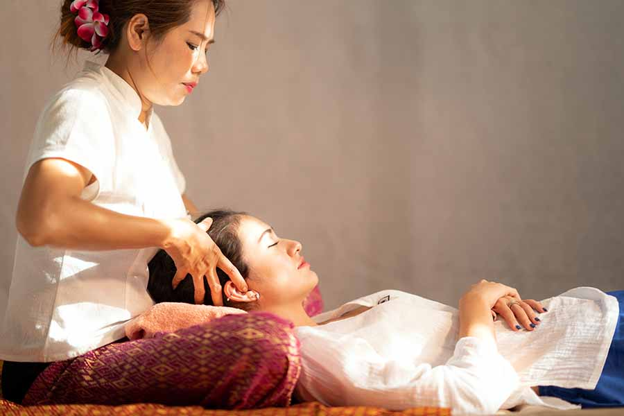 tuina massage singapore session being performed with lady's head massage