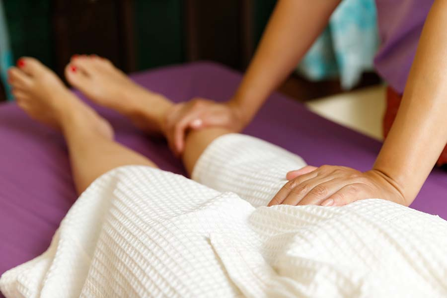Women receiving foot massage.