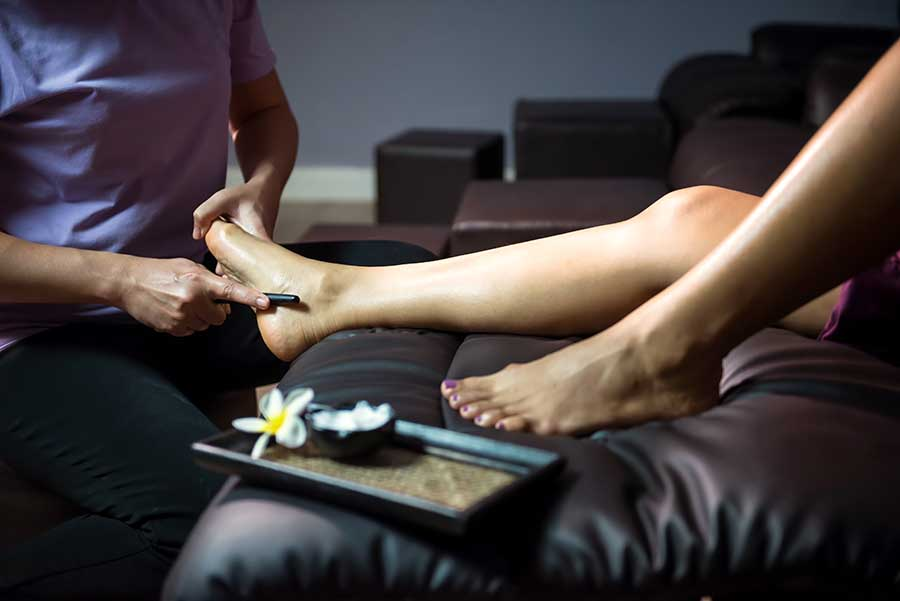 tui na singapore reflexology session for feet