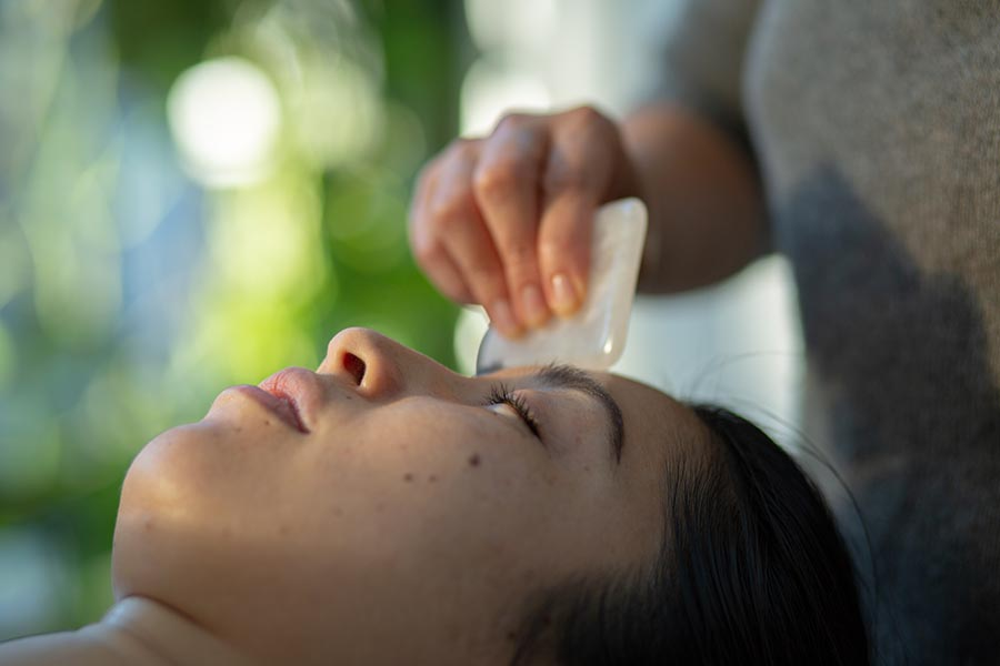 relaxing gua sha treatment by practitioner