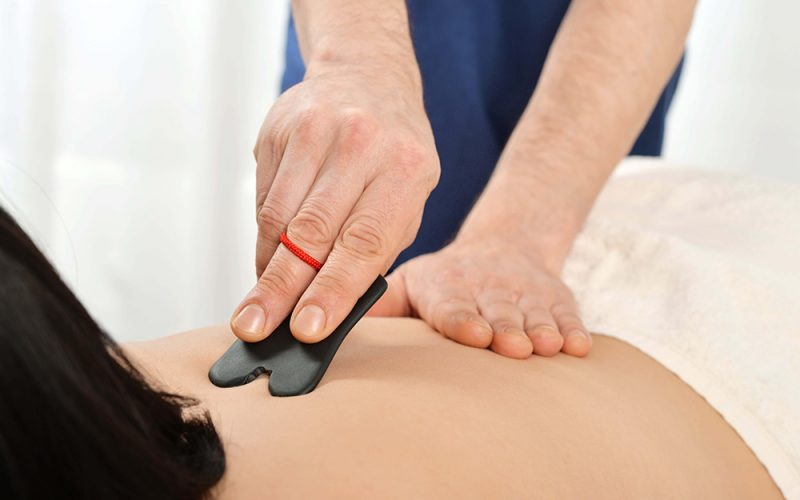 precise gua sha singapore therapy for the back